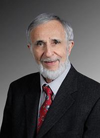 Dr. Charles Lazlo